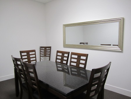 courthouse-suites-on-main-8-person-meeting-room-450x338
